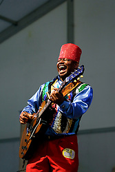 30 April 2015. New Orleans, Louisiana.<br /> The New Orleans Jazz and Heritage Festival. <br /> Lil' Ed and band the Blue Imperials having fun on the Blues stage.<br /> Photo; Charlie Varley/varleypix.com