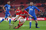 Middlesbrough forward Rudy Gestede (39) slips at the vital moment under pressure from Peterborough United defender Jason Naismith (2) during The FA Cup 3rd round match between Middlesbrough and Peterborough United at the Riverside Stadium, Middlesbrough, England on 5 January 2019.