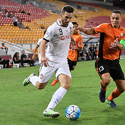BRISBANE, AUSTRALIA - FEBRUARY 21: Xisco Jimenez of Muangthong United is tackled by Jade North of the Roar during the Asian Champions League Group Stage match between the Brisbane Roar and Muangthong United FC at Suncorp Stadium on February 21, 2017 in Brisbane, Australia. (Photo by Patrick Kearney/Brisbane Roar)