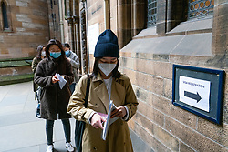 Glasgow, Scotland, UK. 25 September, 2020. Many students at Glasgow University have tested positive for the Covid-19 virus. The Scottish Government has controversially ordered students in several halls of residence where positive cases have spiked, to self-isolate indefinitely. Pictured; New Chinese students queuing to have visa and matriculation processed.  Iain Masterton/Alamy Live News