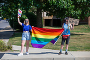 Demonstrators hold signs and a pride flag during a Pride Rally in Milton, Pennsylvania on August 8, 2020. The I Am Alliance organized the event to show support for the LGBTQ community. (Photo by Paul Weave/)