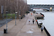 Scene looking a very quiet South Bank riverside walkway with very few people around as the national coronavirus lockdown three continues on 28th January 2021 in London, United Kingdom. Following the surge in cases over the Winter including a new UK variant of Covid-19, this nationwide lockdown advises all citizens to follow the message to stay at home, protect the NHS and save lives.