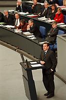 24 NOV 1999, BERLIN/GERMANY:<br /> Gerhard Schröder, SPD, Bundeskanzler, während seiner Rede, im Hintergrund: Regierungsbank, Debatte zum Haushaltsgesetz 2000, Plenum, Deutscher Bundestag, Reichstag<br /> Gerhard Schroeder, Fed. Chancellor, during his speech, during the debate about the butget 2000, plenary, German Bundestag, Reichstag<br /> IMAGE: 19991124-01/02-34
