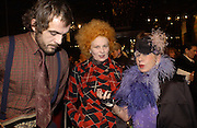 Andreas Kronthaler, Vivienne Westwood and Anna Piaggi. Yves St. Laurent. last couture collection, 1962-2002. Pompidou Centre. Paris. 22 January 2002. © Copyright Photograph by Dafydd Jones 66 Stockwell Park Rd. London SW9 0DA Tel 020 7733 0108 www.dafjones.com
