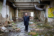 Daniel Low-Beer at one central space which will be left in the form it is before it was reconstrcuted. Mr.  Low-Beer is a British descendant of one of Schindler's factories located in Brnenec, Czech Republic. Mr. Low-Beer is planning to reconstruct the crumbling buildings into a museum. The factory was owned by Daniel Low-Beers grandfather Alfred till 1938, when his family, as Czechoslovak Jews, had to flee the Nazis. Daniel's father came to the UK where Daniel was born.