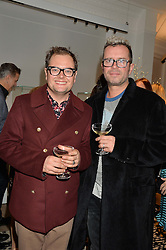 Left to right, ALAN CARR and PAUL DRAYTON at a private view of Stephen Webster's new White Kite collection held at his flagship store at 130 Mount Street, London on 24th November 2016.