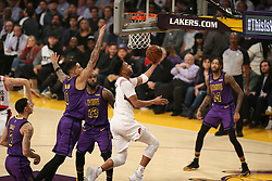 November 14, 2018 - Los Angeles, CA, U.S. - LOS ANGELES, CA - NOVEMBER 14: Portland Trail Blazers Forward Evan Turner (1) goes up and under during the Portland Trail Blazers versus the Los Angles Lakers game on November 14, 2018, at Staples Center in Los Angeles, CA. (Photo by Icon Sportswire) (Credit Image: © Jevone Moore/Icon SMI via ZUMA Press)