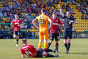 Referee Willie Collum shows the red car to Craig Halkett of Livingstone for his foul on Brad Lyons of St Mirren during the Ladbrokes Scottish Premiership match between Livingston and St Mirren at Tony Macaroni Arena, Livingstone, Scotland on 20 April 2019.