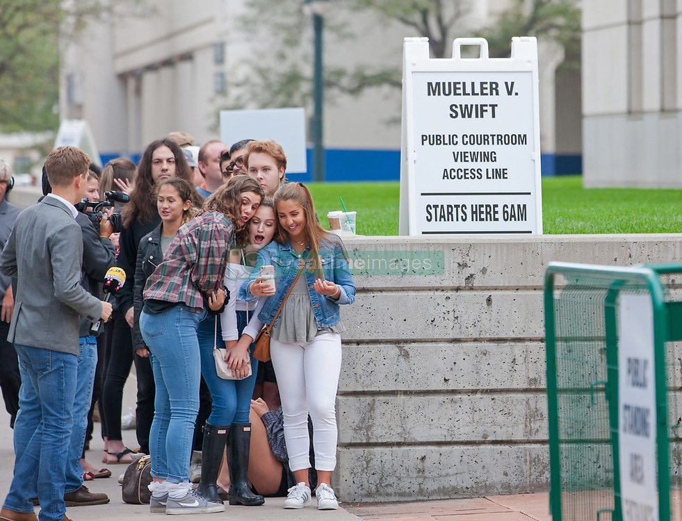 August 8, 2017 - Denver, Colorado, U.S - Swift fans and other people wait in line and take photos as they prepare to enter the courthouse for viewing the Taylor Swift Groping Trial against radio DJ David Mueller at the Alfred A. Arraj United States Courthouse. Swift, has said that Mueller, fondled her four years ago during a photo shoot before a concert in Denver. Mueller sued Swift, claiming she had falsely accused him and it cost him his job at a Denver radio station. Swift is countersuing for assault and battery. (Credit Image: © Matthew Staver via ZUMA Wire)