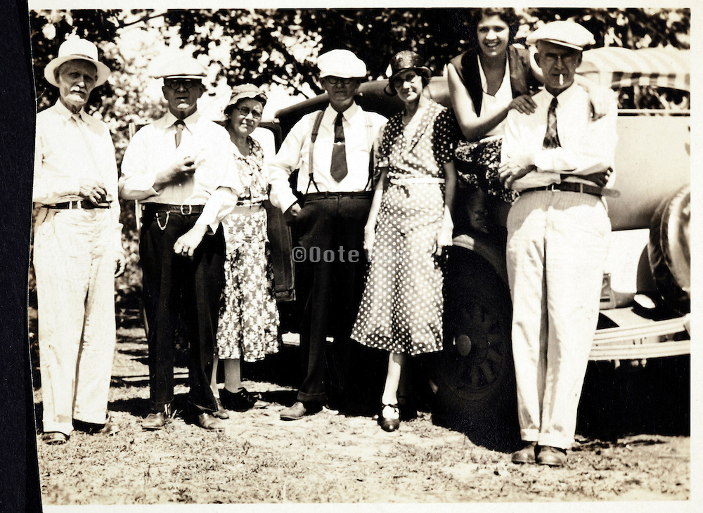 group of adult people and car USA 1920s