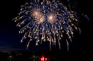 Middletown, New York  - People watch the fireworks display by the lake at Fancher-Davidge Park during Middletown's Stars and Stripes Celebration on June 28, 2014.