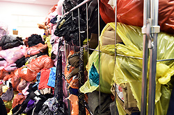 Clothes waiting to be sorted in a Charity shop Uk