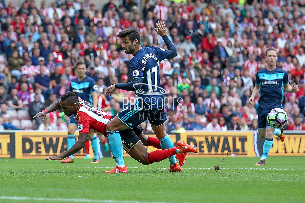 Sunderland forward Jermain Defoe (18)  has a penalty claim turned away as the challenge from Middlesbrough defender Antonio Barragan (17) comes in during the Premier League match between Sunderland and Middlesbrough at the Stadium Of Light, Sunderland, England on 21 August 2016. Photo by Simon Davies.