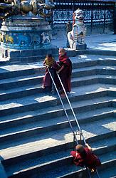 NEPAL KATHMANDU APR95 - Buddhist novices play on the stairs leading up to the Shwayambunath Temple in western Kathmandu. The Shwayambunath temple is one of the three major religious sites in Nepal. <br /> <br /> jre/Photo by Jiri Rezac<br /> <br /> © Jiri Rezac 1995<br /> <br /> Tel: +44 (0) 7050 110 417<br /> Email: info@jirirezac.com<br /> Web: www.jirirezac.com