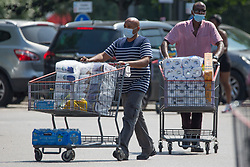 © Licensed to London News Pictures.  22/07/2021. London, UK. Shoppers are seen with full trolleys at Costco in Chingford, north London. Supermarkets have warned they could start running out of food in 48 hours. Many stores had to close due to a lack of workers having to self-isolate.  Photo credit: Marcin Nowak/LNP