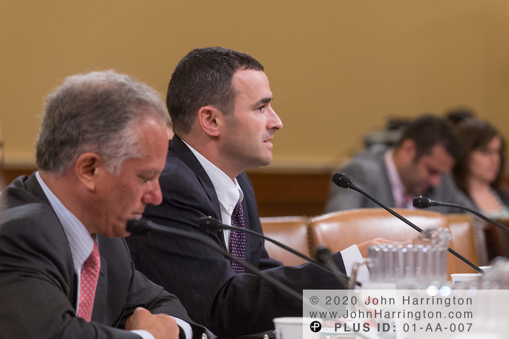 """Daniel Werfel, Principal Deputy Commissioner for Services and Enforcement at the Internal Revenue Service (right) testifies as Gary Cohen, Deputy Administrator and Director, Consumer Information and Insurance Oversight at the U.S. Department of Health and Human Services (left) looks on during the House Committee on Ways and Means hearing on """"The Status of the Affordable Care Act Implementation"""" on Capitol Hill in Washington, DC August 1, 2013."""