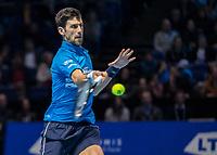 Tennis - 2019 Nitto ATP Finals at The O2 - Day One<br /> <br /> Singles Group Bjorn Borg: Novak Djokovic vs. Matteo Berrettini<br /> <br /> Novak Djokovic (Serbia)lauches the return of serve <br /> <br /> COLORSPORT/DANIEL BEARHAM