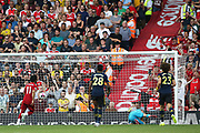 Liverpool forward Mohamed Salah (11) sends Arsenal goalkeeper Bernd Leno (1) the wrong way and scores a goal 2-0 from the penalty spot  during the Premier League match between Liverpool and Arsenal at Anfield, Liverpool, England on 24 August 2019.