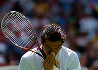 MELBOURNE, AUSTRALIA - JANUARY 23:  Paradorn Srichaphan of Thailand bows to the crowd after  his victory during day five of the Australian Open January 23, 2004 in Melbourne, Australia. (Photo by Lars Mueller/Sportsbeat) *** Local Caption *** -