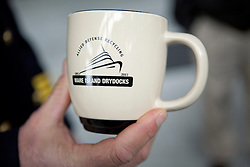 Commemorative mugs were given to hundreds of attendees to mark the official opening of the Allied Defense Recycling, Mare Island Dry Docks.