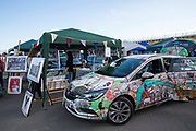 A Vauxhall car decorated by the Artist Kristjana S Williams parked next to her stall at the 2017 Art Car Boot Fair, Folkestone, Kent.