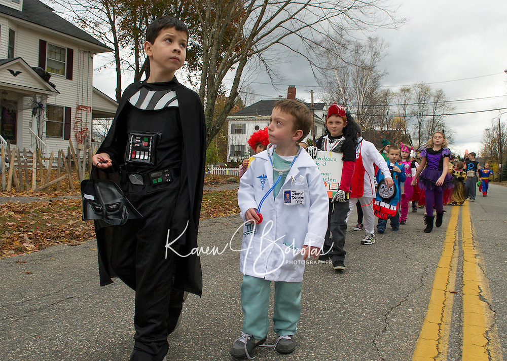 Pleasant Street School students and teachers marched through the streets of Laconia Wednesday afternoon for their Halloween parade.  (Karen Bobotas/for the Laconia Daily Sun)