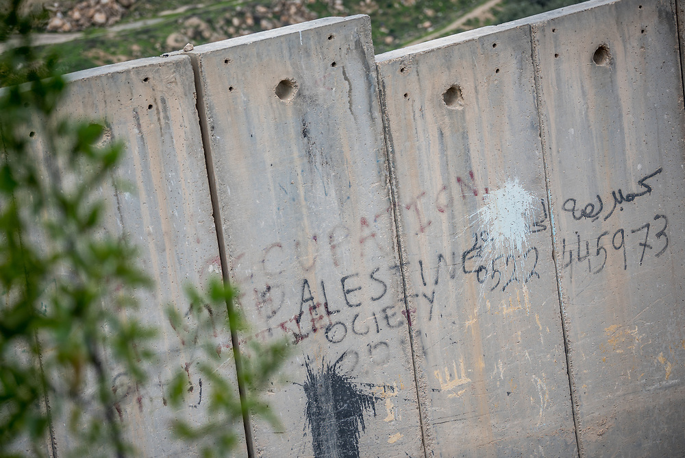 26 February 2020, Abu Dis, Palestine: 'Occupation' reads a text written on the separation wall. The separation wall runs through Abu Dis, closing it off from nearby Al-Shikhsa'ad.