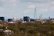 Landscape view of the city of London skyline with iconic buildings including The Shard and Saint Paul's Cathedral dome taken from Primrose Hill, London, England, United Kingdom.