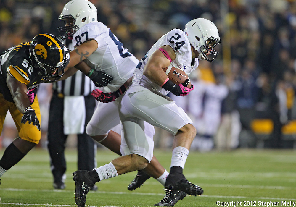 October 20 2012: Penn State Nittany Lions running back Derek Day (24) on a run as tight end Kyle Carter (87) blocks Iowa Hawkeyes linebacker Quinton Alston (52) during the second half of the NCAA football game between the Penn State Nittany Lions and the Iowa Hawkeyes at Kinnick Stadium in Iowa City, Iowa on Saturday October 20, 2012. Penn State defeated Iowa 38-14.