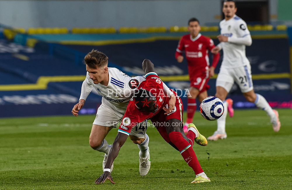 LEEDS, ENGLAND - Monday, April 19, 2021: Liverpool's Sadio Mané is fouled by Leeds United's Diego Llorente (L) during the FA Premier League match between Leeds United FC and Liverpool FC at Elland Road. (Pic by Propaganda)