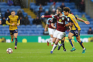 Steven Defour of Burnley passes the ball while under pressure from Bobby Reid of Bristol City. The Emirates FA cup 4th round match, Burnley v Bristol City at Turf Moor in Burnley, Lancs on Saturday 28th January 2017.<br /> pic by Chris Stading, Andrew Orchard Sports Photography.