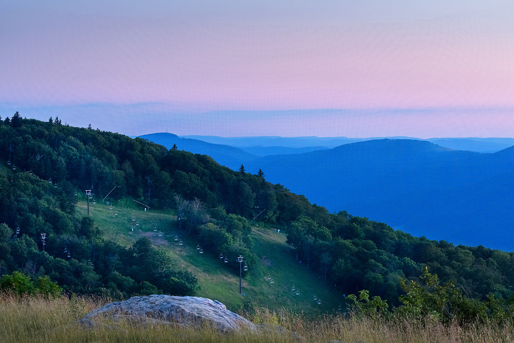 The Canaan Valley ski resort can be seen interposed between the summit of Bald Knob and the distant blue ridges in the dimming Summer twilight