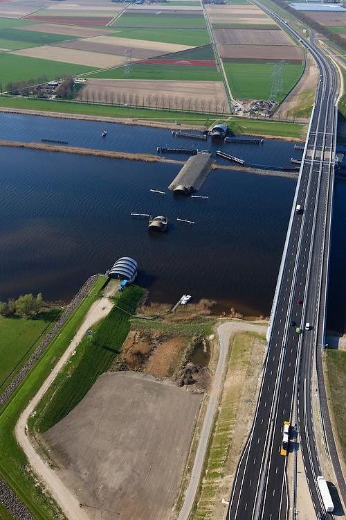 Nederland, Flevoland-Overijssel, Ramspol, 01-05-2013; nieuwe Ramspolbrug in de N50 met naast de brug de balgstuw. De vaargeul in het Ramsdiep met strekdam. <br /> Ramspol, inflatable dike, between Ketelmeer and Black Water. The Balgstuw (bellow barrier) is a storm barrier and consists of an inflatable dam or dyke, composed of three bellows. Usually, each bellow rests on the bottom of the water, but now the bellows are inflated  because of maintenance. luchtfoto (toeslag op standard tarieven)<br /> aerial photo (additional fee required)<br /> copyright foto/photo Siebe Swart