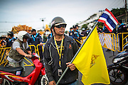 24 NOVEMBER 2012 - BANGKOK, THAILAND:  An anti-government protester with flag of the Thai Royal family before a large anti government, pro-monarchy protest  on November 24, 2012 in Bangkok, Thailand. The Siam Pitak group, which sponsored the protest, cited alleged government corruption and anti-monarchist elements within the ruling party as grounds for the protest. Police used tear gas and baton charges againt protesters.       PHOTO BY JACK KURTZ