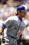 DENVER - 1995:  Mike Piazza of the Los Angeles Dodgers looks on during an MLB game versus the Colorado Rockies at Coors Field in Denver, Colorado during the 1995 season. (Photo by Ron Vesely) Subject:   Mike Piazza
