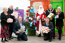 Launching this years Young Peoples Services Annual Toy Appeal at Pargate Retail Park in Rotherham on Friday are, from left to right: Family Support Worker RMBC Ann Levick, Dennis McShane MP, Parkgate Centre Manager Denis Copeland, Santa Clause and  Parkgate Operations Manager Billy Smith, with Mayor of Rotherham Cllr Shaun Wright JP and the  Mayoress of Rotherham Mrs Lisa Wright. 114496-1..11 November 2011. Image © Paul David Drabble