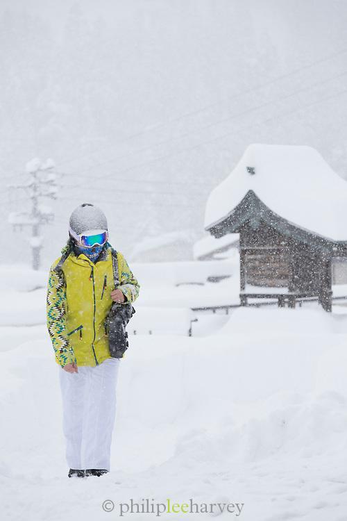 Women in winter clothing walking in snow, Nagano, Japan