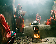 Women (Mother, daughter, grand mother) prepare milk tea and diner, as the men return from the fields where they worked all day. Family life in a Wakhi home. The traditional life of the Wakhi people, in the Wakhan corridor, amongst the Pamir mountains.