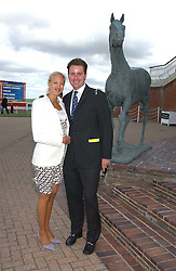 MR HARRY & LADY PORTIA BAKER at the 4th dfay of the 2005 Glorious Goodwood horseracing festival at Goodwood Racecourse, West Sussex on 29th July 2005.    <br /><br />NON EXCLUSIVE - WORLD RIGHTS
