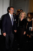 Mr. and Mrs. Roger Moore, Giorgio Armani, ' A retrospective' sponsored by Mercedes, Royal Academy, 14 October 2003. © Copyright Photograph by Dafydd Jones 66 Stockwell Park Rd. London SW9 0DA Tel 020 7733 0108 www.dafjones.com