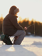 Fisherman on a lake, Norrbotten, Sweden, Lapland.
