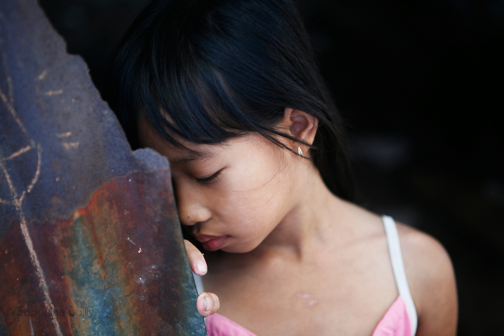 Cai Be, on a bank of the first arm (Tien Gang) of the Mekong River, Vietnam. March 18th 2007..A girl of the village..