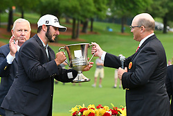 May 5, 2019 - Charlotte, NC, U.S. - CHARLOTTE, NC - MAY 05: Max Homa is presented the Trophy for winning the 2019 Wells Fargo Championship on May 05, 2019 at Quail Hollow Club in Charlotte,NC. (Photo by Dannie Walls/Icon Sportswire) (Credit Image: © Dannie Walls/Icon SMI via ZUMA Press)
