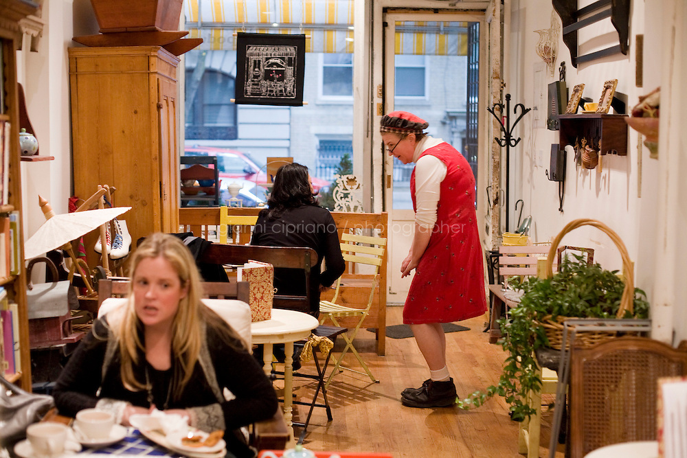 """5 November, 2008. New York, NY. Owner Elspeth Treadwel talks to a customer at the, Podunk, a self-styled """"American tearoom"""" in the East Village. She left a career in publishing to open Podunk six years ago, in 2002.<br /> <br /> ©2008 Gianni Cipriano for The New York Times<br /> cell. +1 646 465 2168 (USA)<br /> cell. +1 328 567 7923 (Italy)<br /> gianni@giannicipriano.com<br /> www.giannicipriano.com"""