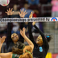 111414  Adron Gardner/Independent<br /> <br /> Navajo Prep Eagles Gabrielle Noon (10), left, and Leshauntai Adams (9) block a Texico Wolverine spike during the New Mexico state volleyball finals at the Santa Ana Star Center in Rio Rancho Friday.