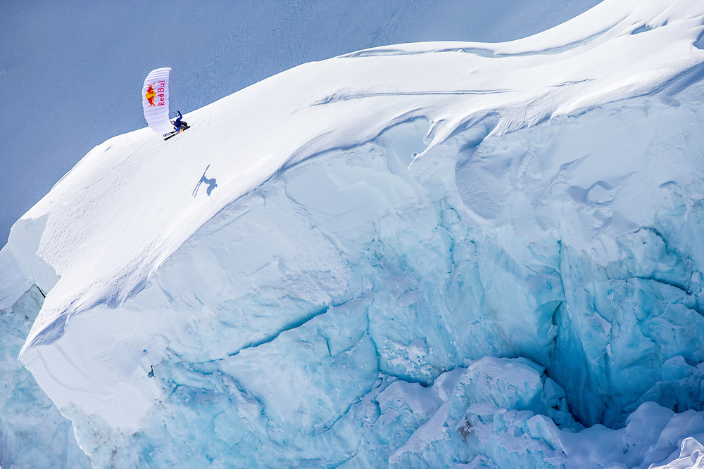 Andy Farington jumps off a large glaricer cliff while filming for the Unrideables in the Tordrillo Mountains near Anchorage, Alaska on April 29th, 2014.