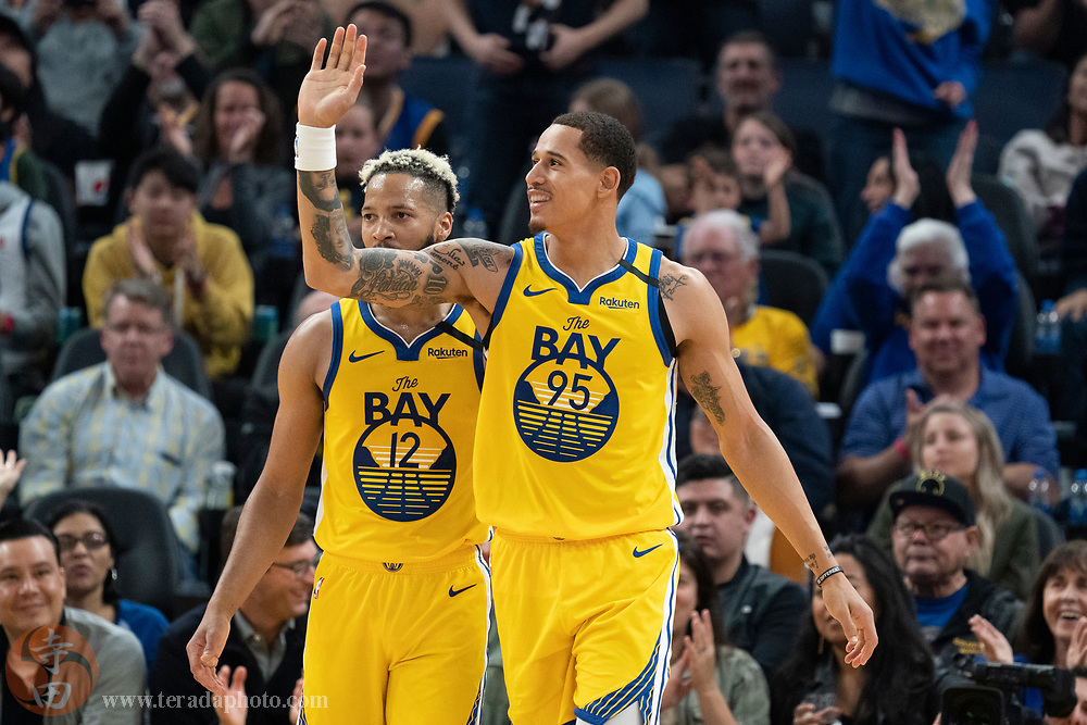February 23, 2020; San Francisco, California, USA; Golden State Warriors forward Juan Toscano-Anderson (95) celebrates during the third quarter against the New Orleans Pelicans at Chase Center.