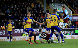 Burnley's Peter Crouch (right) attempts a shot on goal