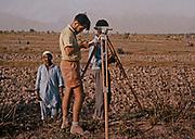 Western European surveyor working on engineering project in rural Pakistan 1962