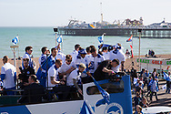 Players on the open top bus during the Brighton & Hove Albion Football Club Promotion Parade at Brighton Seafront, Brighton, East Sussex. United Kingdom on 14 May 2017. Photo by Ellie Hoad.